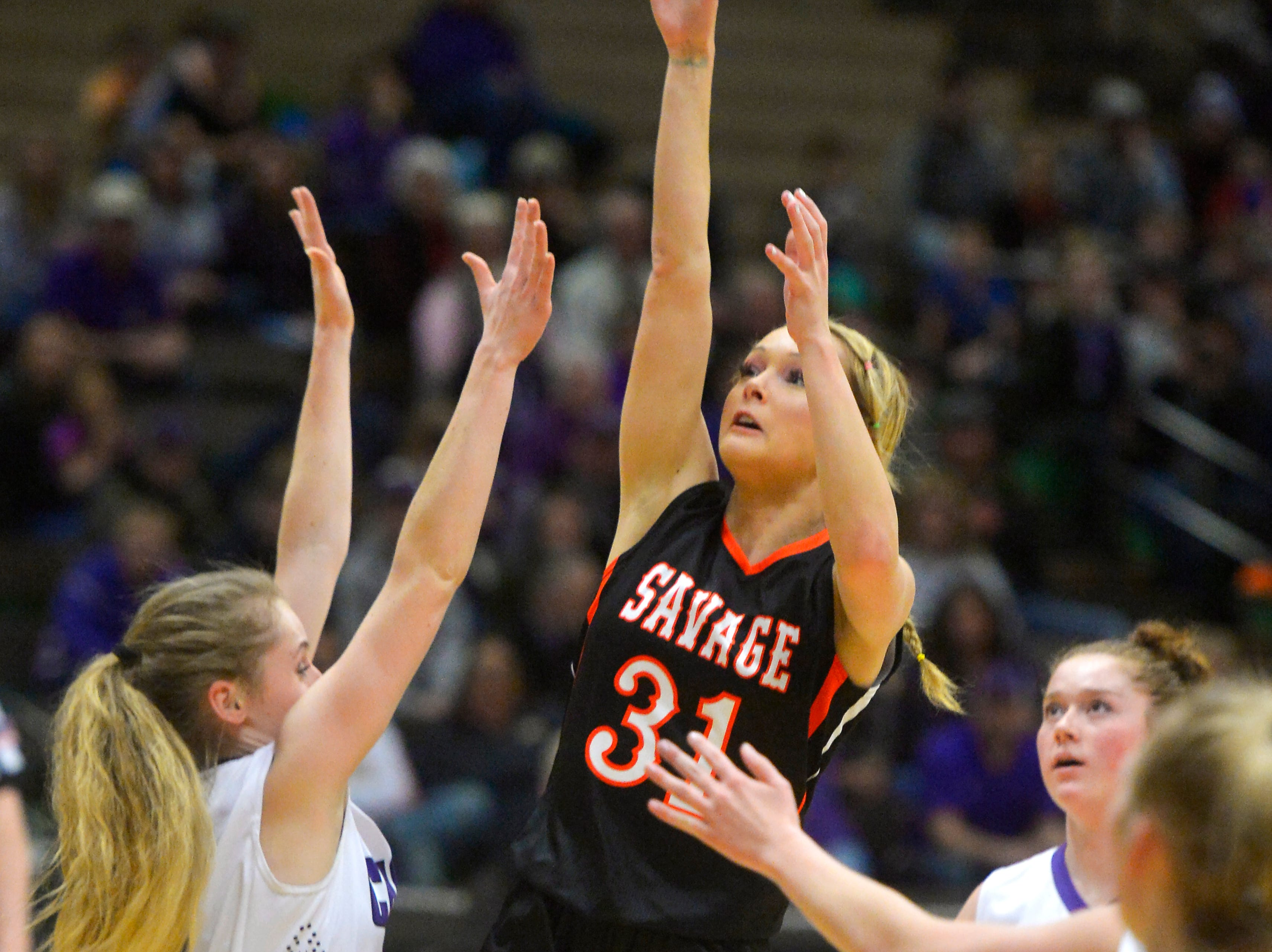 Savage's Tyler Lien shoots in Thursday's game against Charlo during the Girls State C Basketball Tournament in the Four Seasons Arena.
