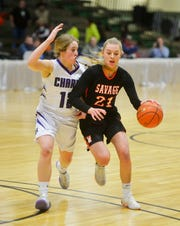Savage's Soda Rice handles the ball as Charlo's Liev Smith defends during the Girls State C Basketball Tournament on Thursday in the Four Seasons Arena.