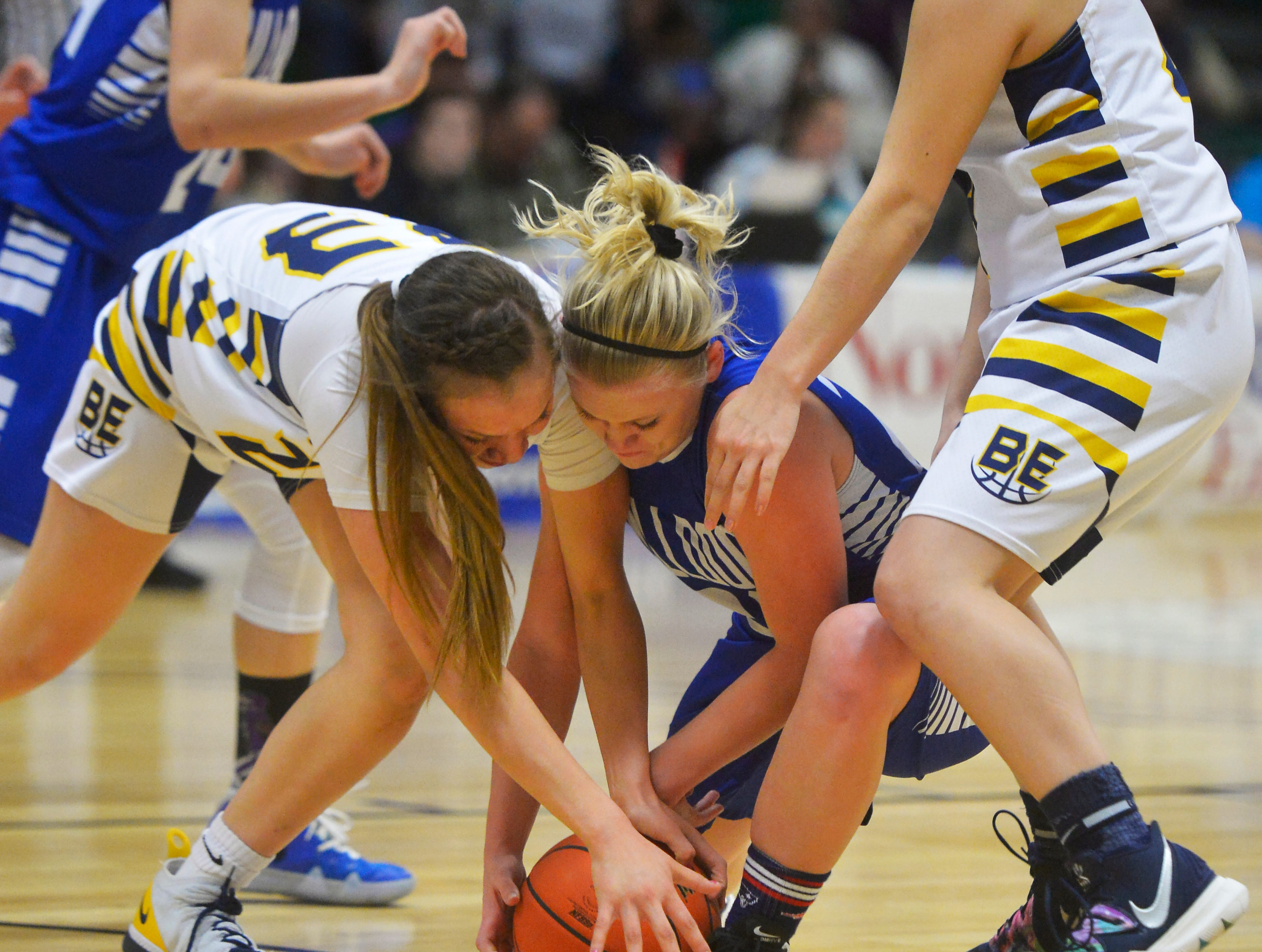 Box Elder's Kyla Momberg, lef, and Carter County's Kari Kittelmann go to the floor for a loose ball during the Girls State C Basketball Tournament on Thursday in the Four Seasons Arena.