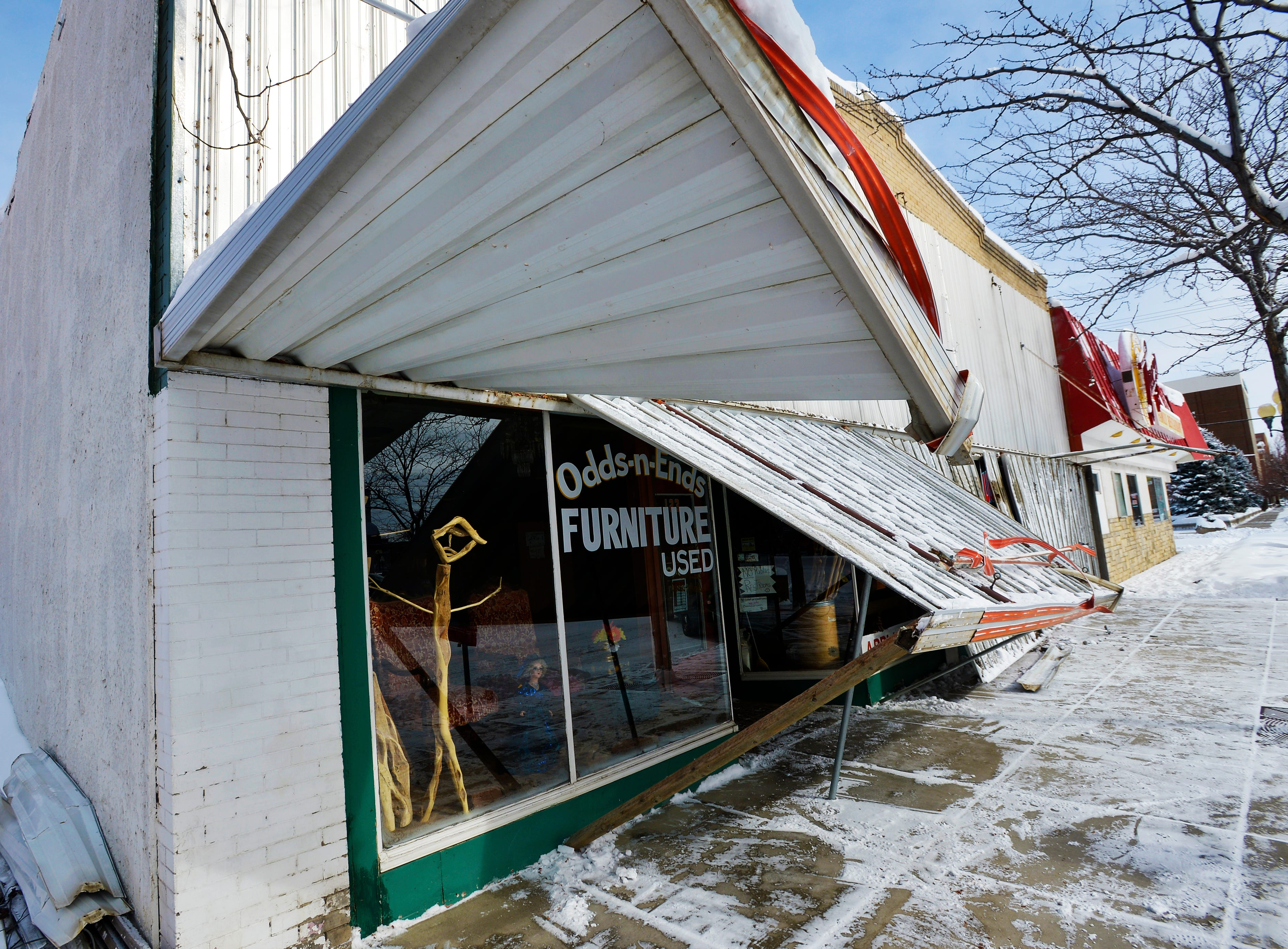 The awning collapsed at Odds-n-Ends furniture store on Central Avenue.