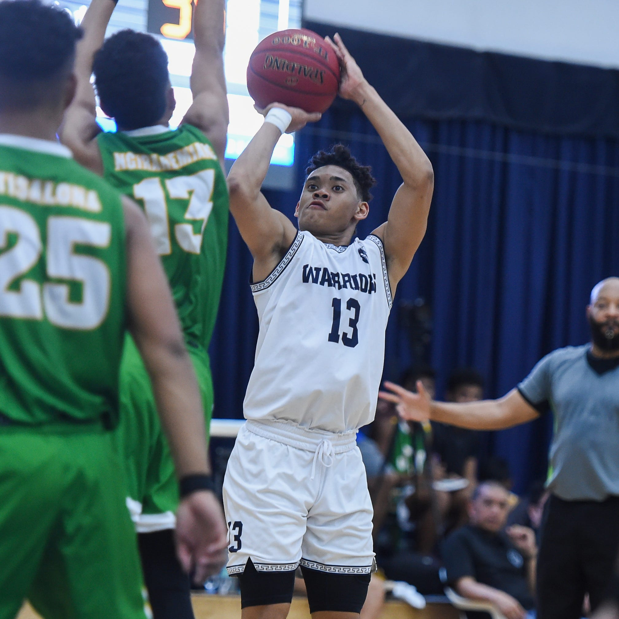 Warriors control game throughout, win 62-48 against rival JFK