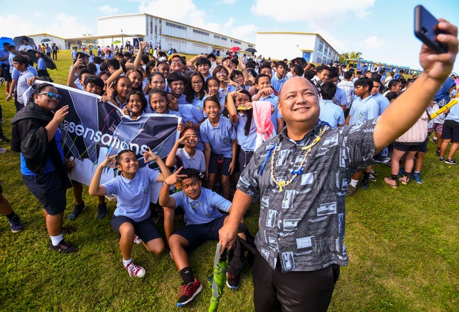 Guam Department of Education Superintendent Jon Fernandez captures a social selfie with VSA Benavente Middle School students prior to their Peace March in Dededo on Friday, March 1, 2019.