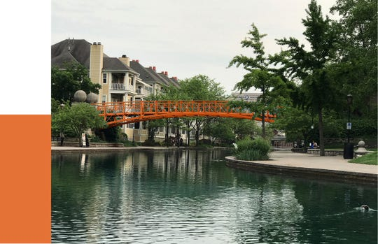 The Indianapolis Department of Metropolitan Development will paint the Downtown Canal's Walnut Street Pedestrian Bridge bright orange.