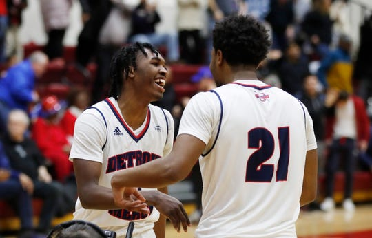 Detroit Mercy guards Antoine Davis, left, and Lamar Hamrick (21) greet each other after the team's 87-85 win over IUPUI in an NCAA college basketball game, Thursday, Feb. 28, 2019, in Detroit. Davis broke Stephen Curry's freshman 3-point record early in the second half and finished with 20 points. Davis swished a 30-footer from the right wing for shot No. 123 beyond the arc to surpass the mark Curry set at Davidson 12 years ago.