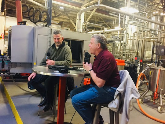 Colts coach Frank Reich (left) had the crowd laughing during an hour-long interview with NBC Sports' Peter King Friday night at SunKing Brewery.