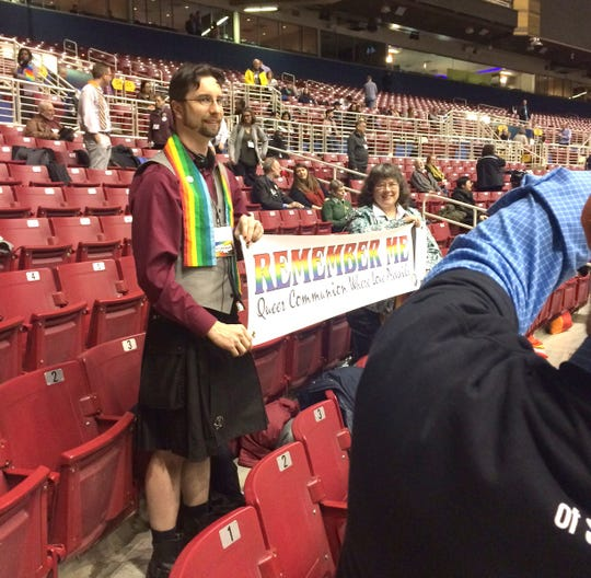 Pastor Sean McRoberts of St. Mark's United Methodist Church in St. Louis speaking at the UMC conference, wearing the skirts, kilts and painted fingernails he regularly wears.