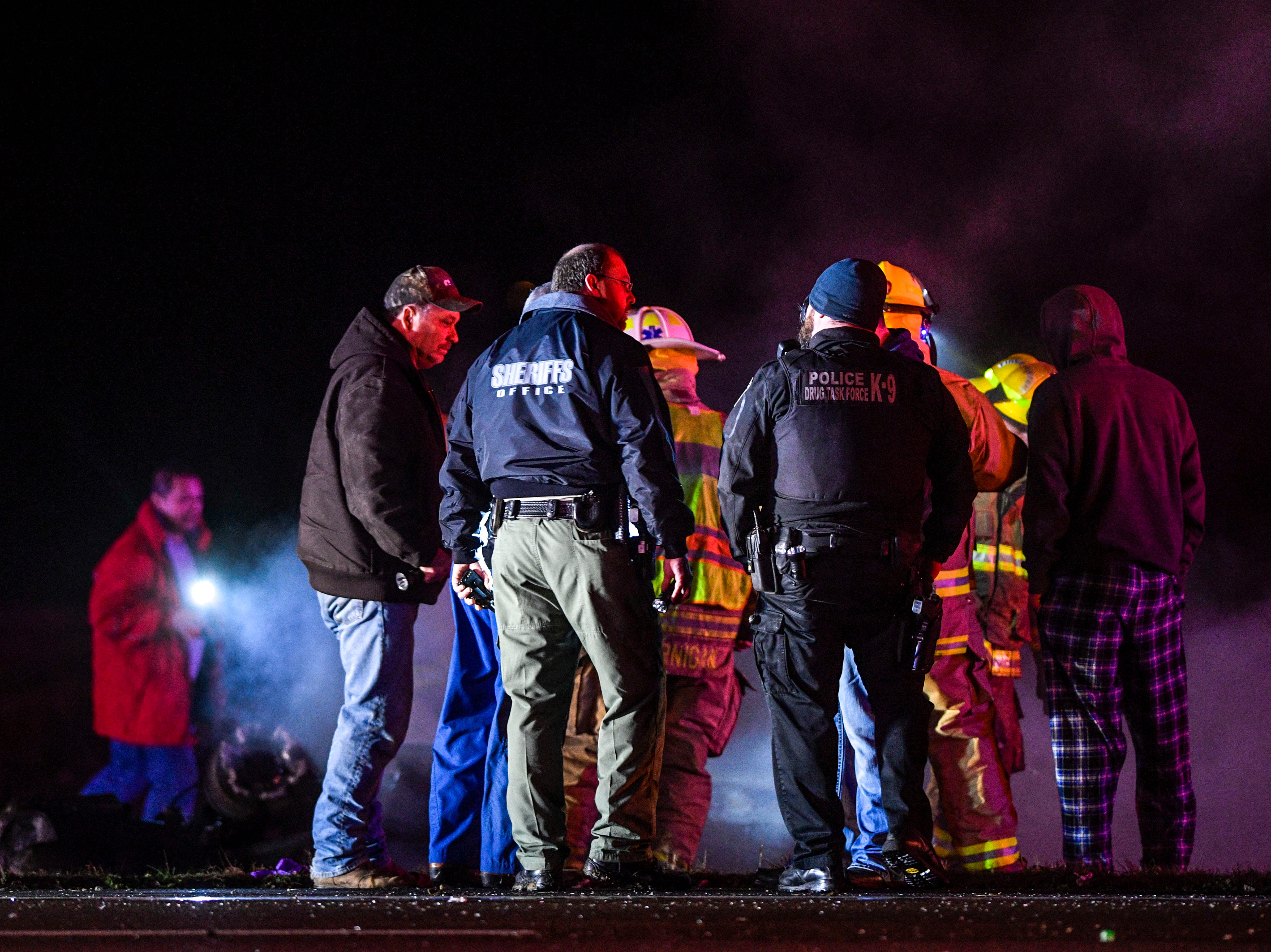 First responders from multiple departments assess the scene of a crash where a driver drove off the road, impacted a ditch, and their vehicle caught fire when going eastbound on US 412 just passed Lower Jackson Rd, in Bells, Tenn., on Friday, March 1, 2019.
