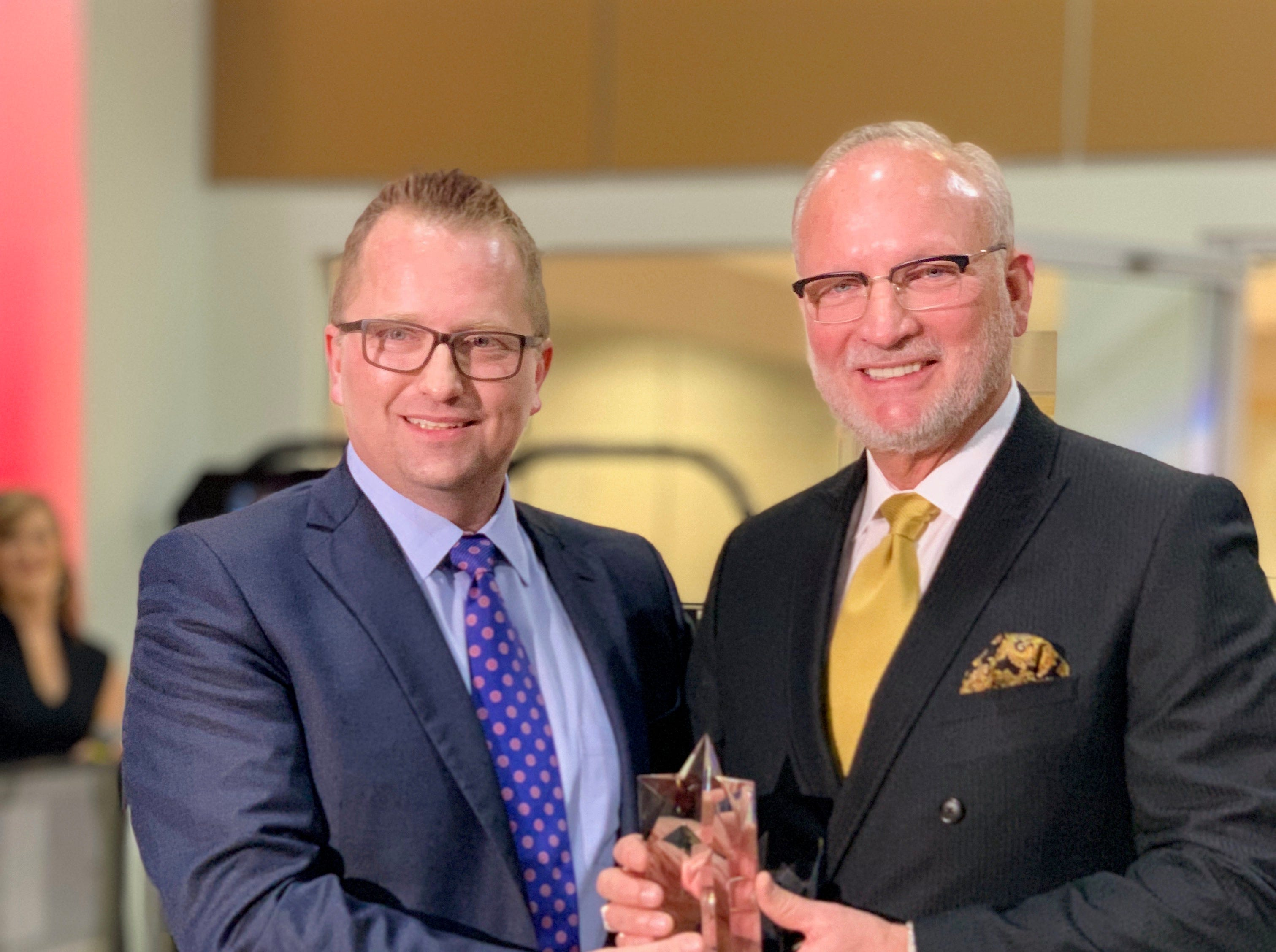 Shane Sizemore (left), Toyota Cincinnati Region general manager, recently presented a 25-year anniversary award to Doug White, general manager and co-owner of Toyota Knoxville in Tennessee. The award celebrates the dealer's commitment to Toyota and the community.
