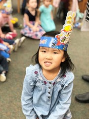 Four-year-old Kailee Choi wears a Dr. Seuss birthday party hat. March 1, 2019.