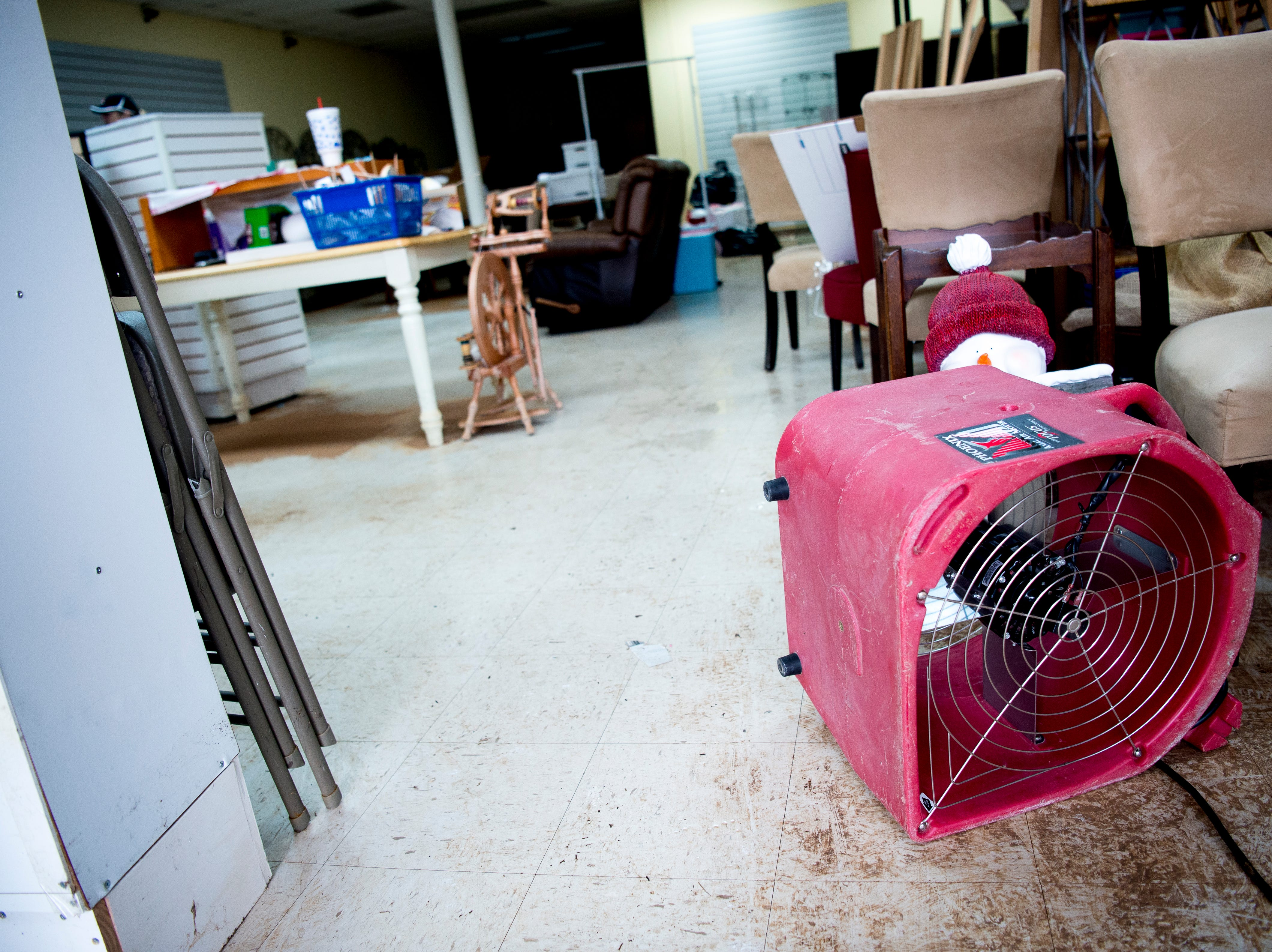 A fan blows damp air from The Yarn Haven at 464 Cedar Bluff Road in Knoxville, Tennessee on Friday, March 1, 2019. Nearly a quarter of the stores inventory including furniture and paperwork was lost in the floodwaters, which reached over a foot in depth. The owners estimate it will take them a minimum of two months until they can open up shop again.
