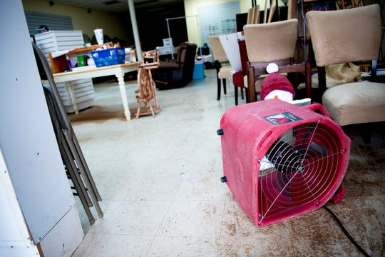A fan blows damp air from The Yarn Haven on Friday.