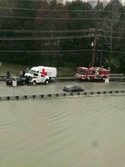 "From the Knoxville Police Department on March 1: This vehicle just got stuck in water on Northshore Drive at Town Center Boulevard, and as the driver was being rescued another driver got stuck. ""Turn around don't drown."""