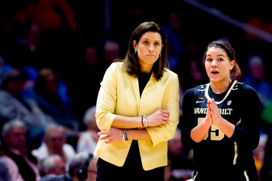 Vanderbilt Head Coach Stephanie White speaks with Vanderbilt guard Kaleigh Clemons-Green (35) during a game between the Tennessee Lady Vols and Vanderbilt at Thompson-Boling Arena in Knoxville, Tennessee on Thursday, February 28, 2019.