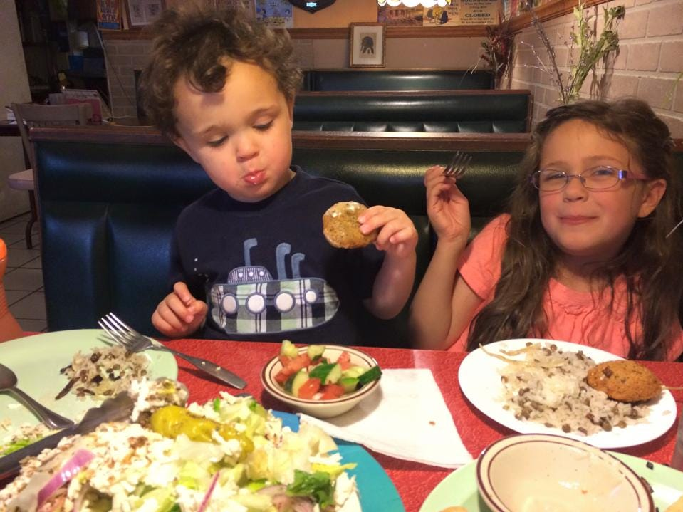 "South Knoxville residents RJ and Amelia Bumpus enjoy falafels and koshari, a favorite meal, along with ""the best Greek Salad in Knoxville"" at King Tut Grill in South Knoxville."