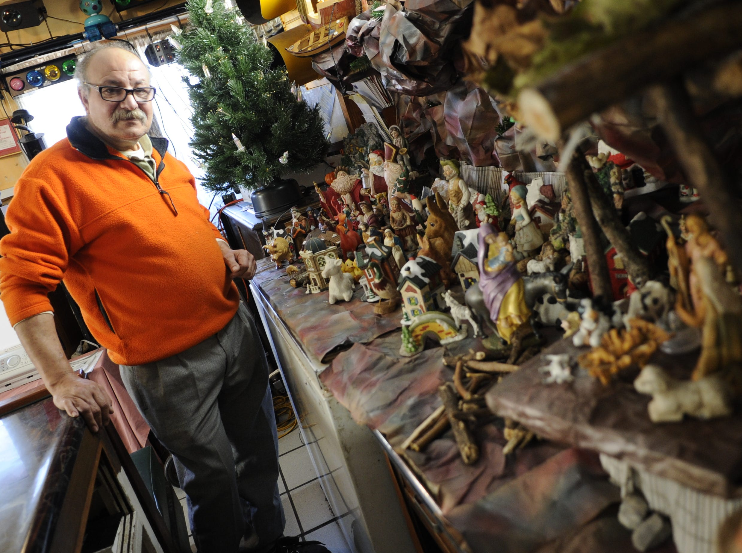 Mo Girgis, owner of King Tut Grill in South Knoxville, has built a unique collection into a Nativity scene along a wall in his eatery. Girgis has been in  business for 18 years and displays the items yearly.