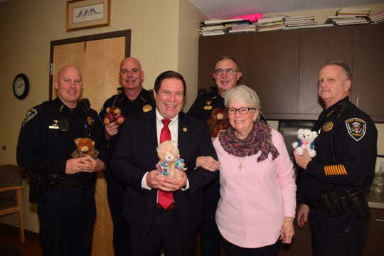 Sheriff's officers received 65 dressed teddy bears at Karns Senior Center Thursday, Feb. 21. In front are Sheriff Tom Spangler and Jo-Ann Izzo; (back, from left) Chris Allison, Glen Simerly, Scott DeArmond and Chief Deputy Barney Lion. The officers enjoy giving them out to children they meet in the line of duty, Spangler said.
