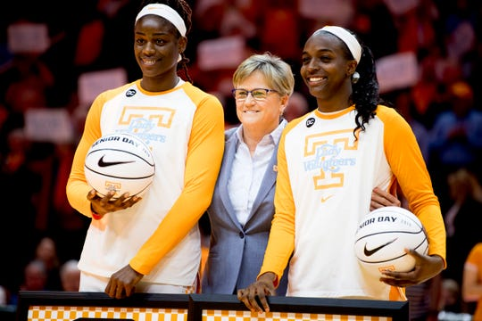 Tennessee forward Cheridene Green (15), Tennessee Head Coach Holly Warlick and Tennessee guard/forward Meme Jackson (10) during a senior night celebration at Thompson-Boling Arena in Knoxville, Tennessee on Thursday, February 28, 2019.