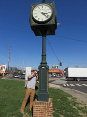 Joe Pendley works on keeping the Bearden clock operating smoothly.