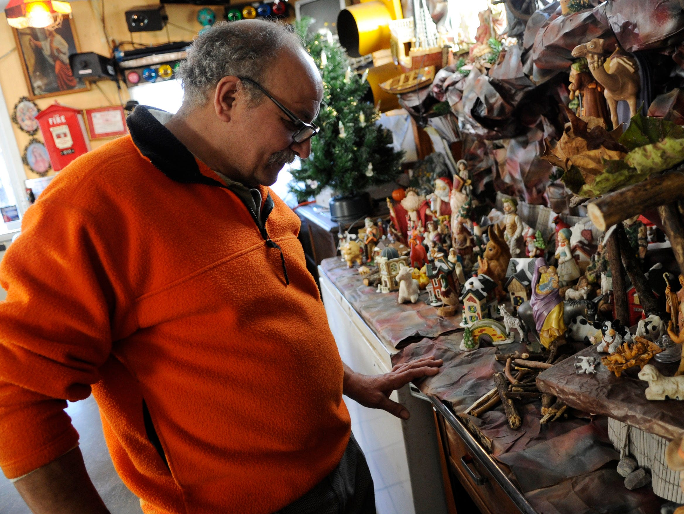 Mo Girgis, owner of King Tut Grill in South Knoxville, has built a unique collection into a Nativity scene along a wall in his eatery.