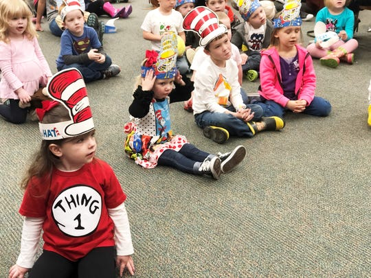 """Three-year-old Madilyn Delaney wore a """"Thing 1"""" shirt made by her mother to the Read Across America story time at Halls Branch Library on March 1, 2019."""
