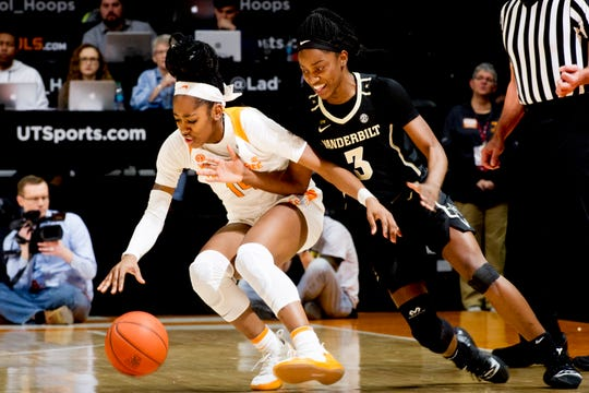 Tennessee guard Zaay Green (14) and Vanderbilt guard Jordyn Cambridge (3) chase a lose ball during a game between the Tennessee Lady Vols and Vanderbilt at Thompson-Boling Arena in Knoxville, Tennessee on Thursday, February 28, 2019.