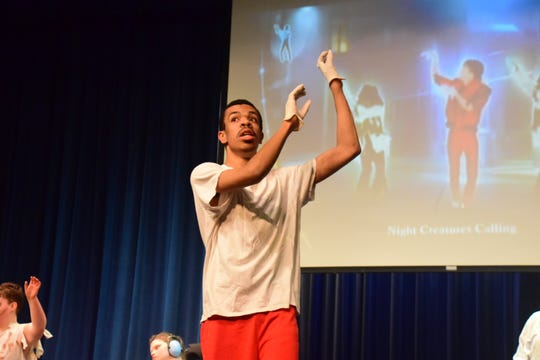 "Lewis Pope leads Brittany Williamson's special needs class in dancing Michael Jackson's ""Thriller"" at the Karns High School Community Talent Show."