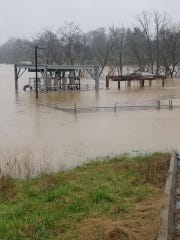 The First Utility District of Knox County waste water pumps off Ebeneezer Road, some 20 feet off the ground, are seen under water.