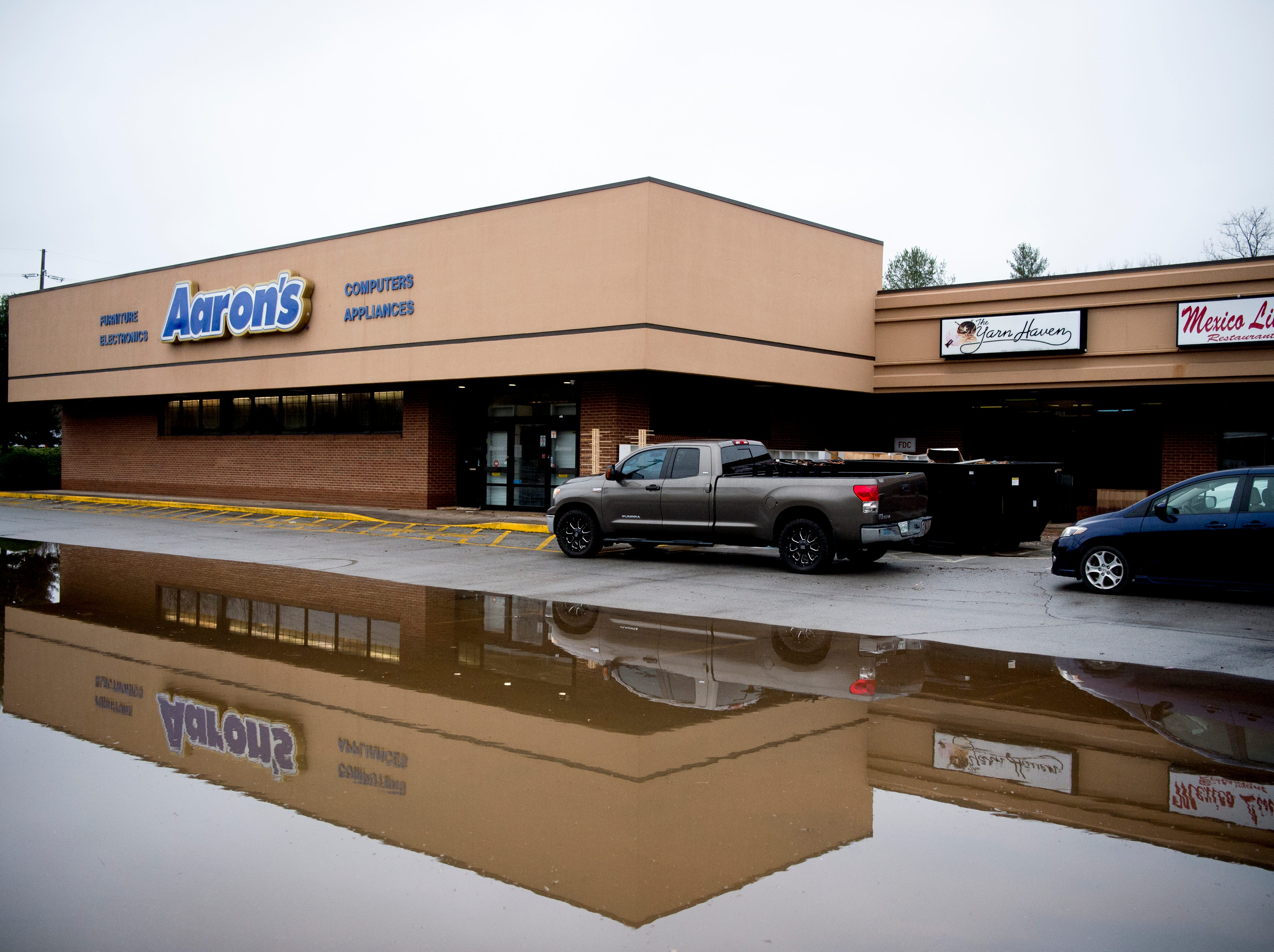 A large pool of water still stands in the parking lot outside of The Yarn Haven at 464 Cedar Bluff Road in Knoxville, Tennessee on Friday, March 1, 2019. Nearly a quarter of the stores inventory including furniture and paperwork was lost in the floodwaters, which reached over a foot in depth. The owners estimate it will take them a minimum of two months until they can open up shop again.