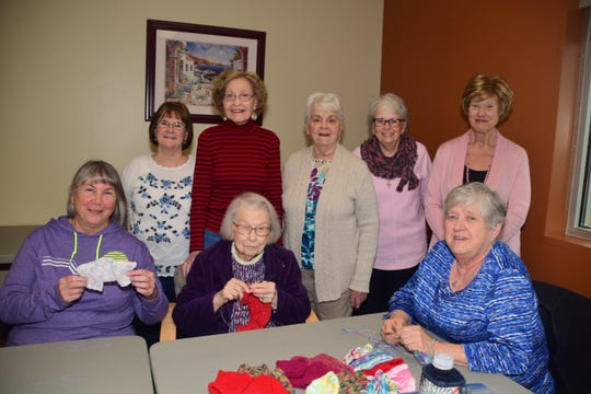 The Crafting Social Group – Barbara Prevost, Charlene Asbury, Sherry Scott; (back) Eileen Murrell, Betty Parrish, Jody Gillenwaters, Jo-Ann Izzo and Bonnie Murrey – all say they are ready to start on the next batch of teddy bears bound for the Knox County Sheriff's Office.