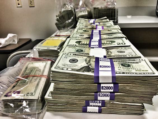 More than $250,000 in cash was seized.