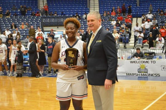 Lafayette Christian's Bre Porter (left) poses with LHSAA Executive Director Eddie Bonine after being named as the MVP of the Division IV championship game.