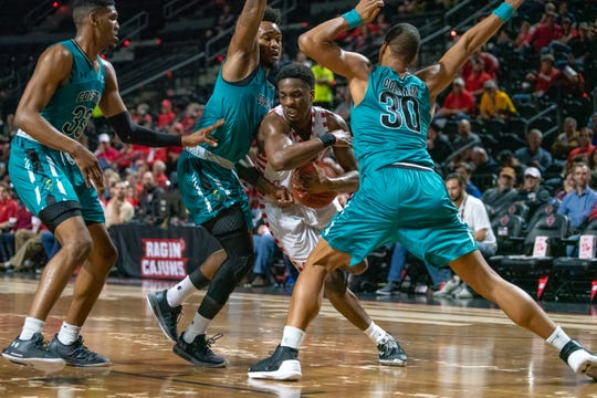 UL point guard Marcus Stroman drives into the defense during Thursday night's win over Coastal Carolina.