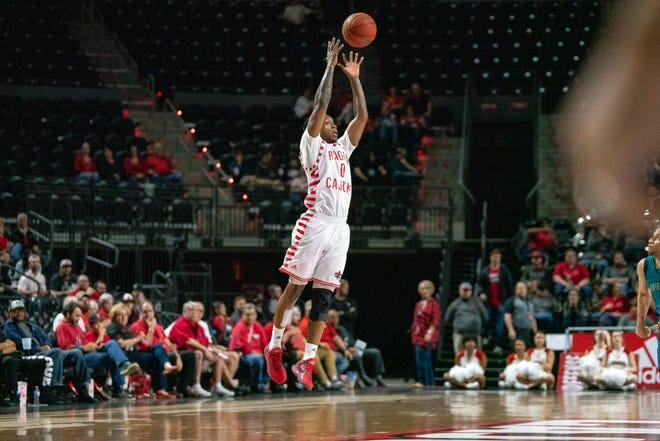 UL's Cedric Russell jumps high to catch the ball as the Ragin' Cajuns take on the Coastal Carolina Chanticleers at the Cajundome on Feb. 28, 2019.