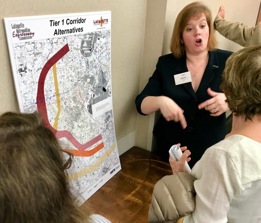 Kate Prejean, HNTB Corp. senior project manager, discusses the Lafayette Regional Xpressway during a Thursday public hearing at the South Regional Library.