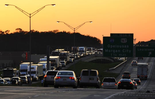 Heavy traffic on Interstate 10 in Lafayette near the exit for I-49.