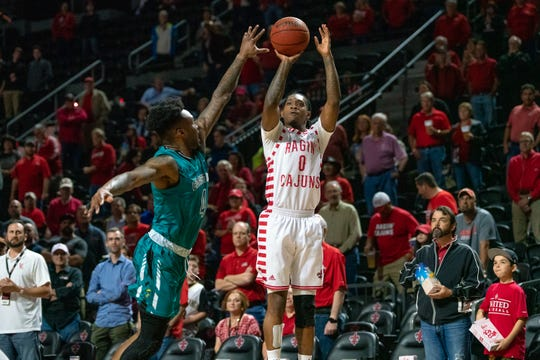 UL's Cedric Russell shoots a 3-pointer in a win over Coastal Carolina last week.