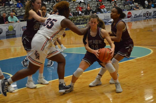 Vermilion Catholic's (11) Ainsley Mallet fights for a loose ball against Lafayette Christian's Bre Porter Friday during the Division IV finals in Alexandria.