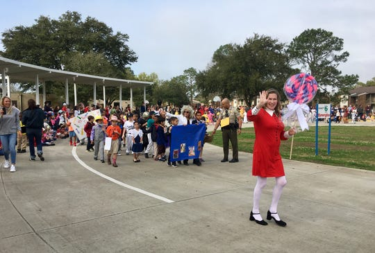 "Woodvale Elementary celebrates reading with its annual book character parade Friday, March 1, 2019. Each class and grade level reads a different book and relates it to one of the seven habits of the Leader In Me program. Administration dressed up as characters from ""Charlie and the Chocolate Factory."""