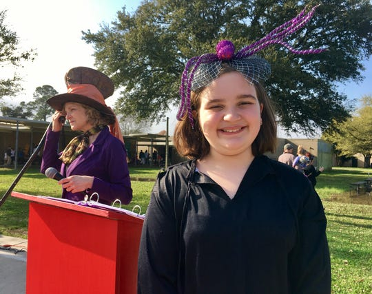 "Woodvale Elementary fourth-grader Evie Doucet emceed her school's annual book character parade Friday, March 1, 2019. She is dressed as a dementor from Harry Potter, which was the theme for her class in the parade. Behind her is Principal Monique Vidos as the Mad Hatter from ""Charlie and the Chocolate Factory."""