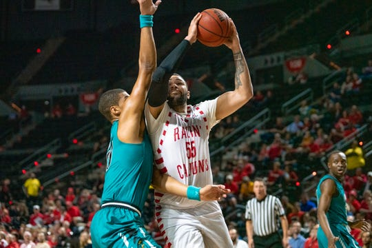 UL's Justin Miller, shown here driving to the basket against Coastal Carolina earlier this season, is leaving the Ragin' Cajuns after three seasons.