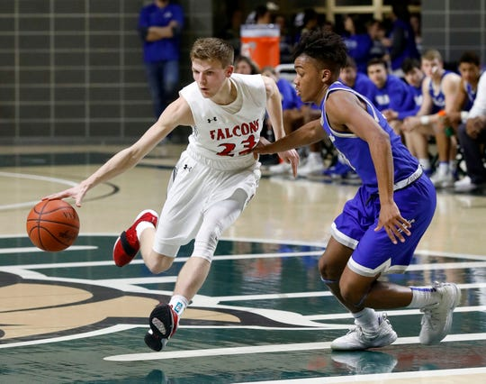 Fairfield Union's Chase Poston tries to drive past Washington Court House's Evan Upthegrove during Thursday night's Division II District Semifinal, Feb. 28, 2019, at the Convocation Center at Ohio University in Athens.