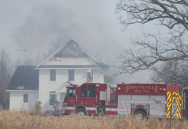 Fowlerville and Putnam firefighters, as well as Livingston County EMS, on the scene of a house fire on Kern Road in Iosco Township Friday, March 1, 2019.