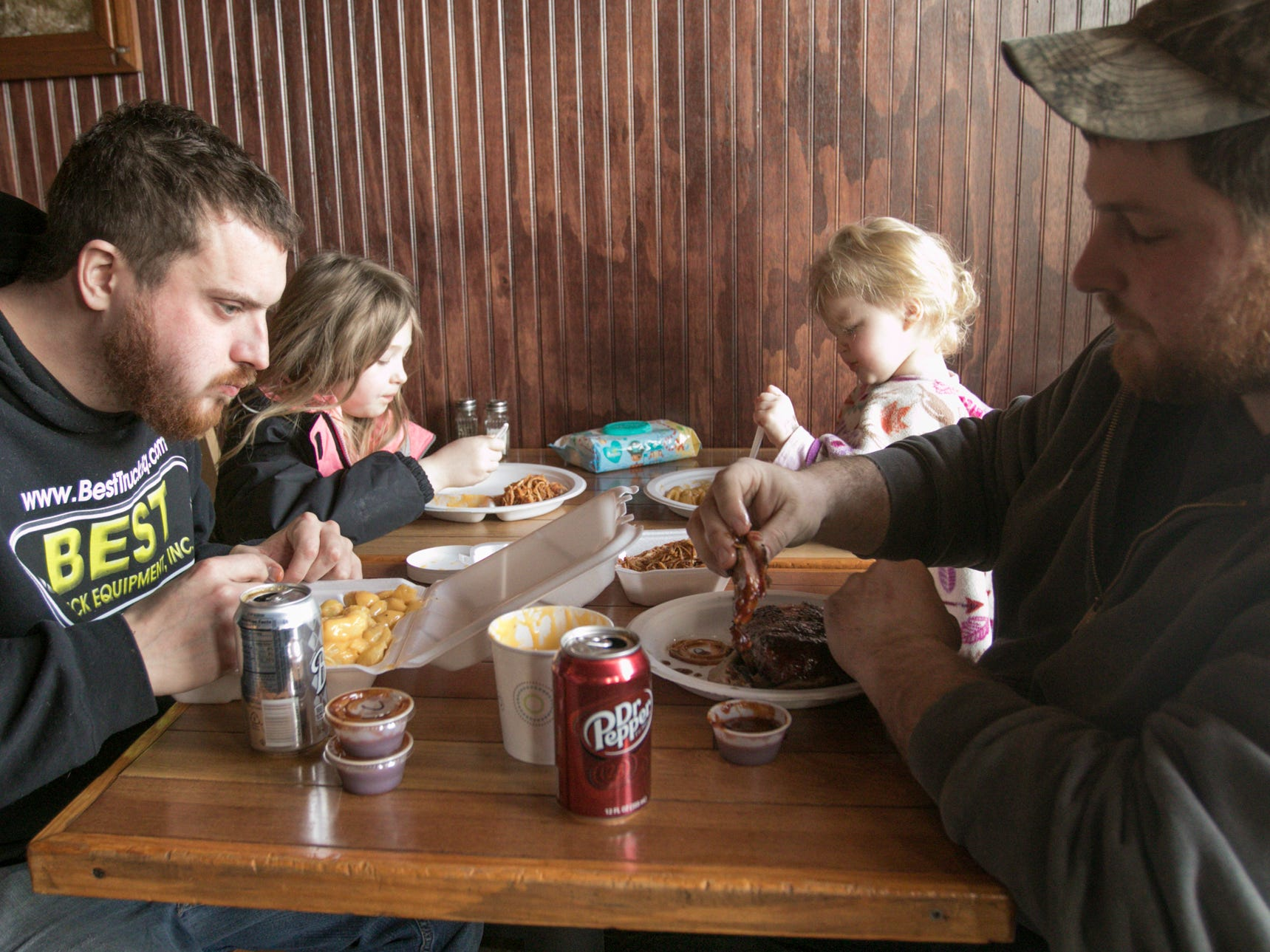 From left, Josh Moreau, Carley Bylski, Lilah Parker and Carley and Liliah's father Daren Parker enjoy a meal at Hotel Hickman Chuckwagon BBQ Friday, March 1, 2019.