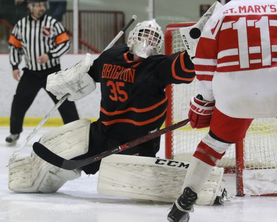 Brighton's Harrison Fleming makes one of his 24 saves in a 2-1 loss to Orchard Lake St. Mary's in a regional hockey semifinal on Thursday, Feb. 28, 2019.