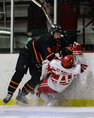Brighton's Tim Erkkila checks Orchard Lake St. Mary's Bryce Kallen to the ice in a 2-1 regional semifinal loss to the Eaglets on Thursday, Feb. 28, 2019.