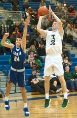 Trinity's Stan Turnier puts up a shot against Eastern in the Seventh Region semifinal.