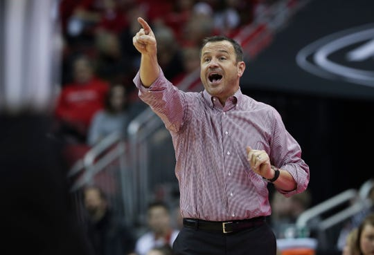 U of L head coach Jeff Walz instructs his team in opposition to NC State at the Yum Center. Feb. 28, 2019