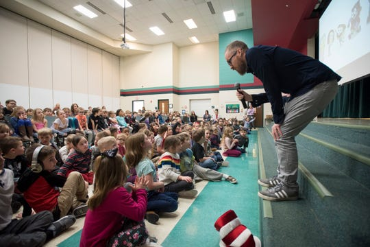 """Shane Houghton, co-creator of Disney's """"Big City Greens"""" answers questions from Gateway North Elementary students in St. Johns, Friday, March 1, 2019.  He and brother Chris live and work in Los Angeles. They both graduated from St. Johns Public Schools."""