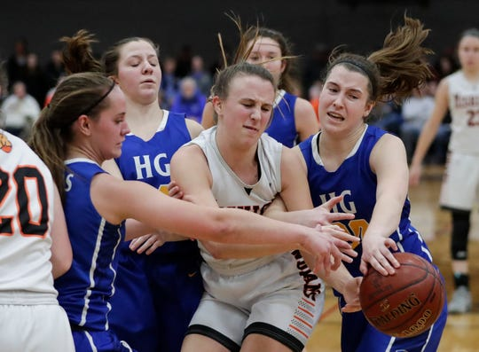 Mishicot's Kylie Schmidt (31) fights Howards Grove defenders for a rebound during a WIAA Division 4 semifinal game Thursday at Kohler High School.