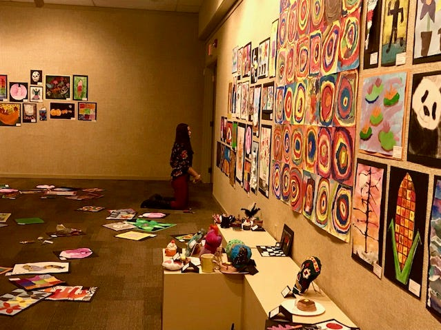 Teachers arrange art for Youth Art Show